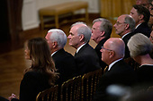 United States First Lady Melanie Trump, United States Vice President Mike Pence, United States Acting Secretary Richard V. Spencer, United States Department of Defense Ambassador John Bolton attend a ceremony in the East Room of the White House in Washington D.C., U.S. on July 18, 2019, where the D-Day flag was presented to United States President Donald J. Trump.<br /> <br /> Credit: Stefani Reynolds / CNP