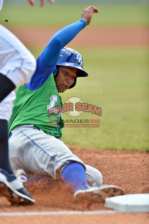 Lexington Legends second baseman Carlos Garcia (6) slides into third during a game against the Asheville Tourists on May 3, 2015 in Asheville, North Carolina. The Legends defeated the Tourists 6-3. (Tony Farlow/Four Seam Images)