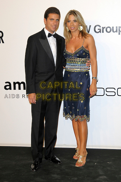 GIOVANNI BOZZETTI & DONATELLI.The amfAR Gala at La Permanente during the Mailand Fashion Week Spring/Summer 2010 - Milan, Italy. .September 28th, 2009.full length black tuxedo blue pattern dress married husband wife gold waistband .CAP/RD.©Richard Dean/Capital Pictures.