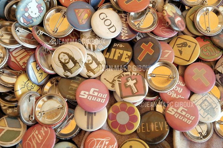 "BUSHNELL, ILLINOIS - JULY 3 : Religious buttons on sale at the Cornerstone Festival in Bushnell, Illinois, on July 3rd, 2004. The Cornerstone Festival is a Christian Music Festival organized by ""the Jesus People USA"", held annually on the Fourth of July weekend in centrak Illinois since 1984. Thousands of Believers gather for 4 days of music and worship, with over 200 bands representing all styles of the current musical landscape. (Photo by Jean-Marc Giboux/Getty Images)"