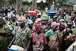 People waiting for a distribution in Mweso, just 20% of the Idp camp papulation gets the food they need for the entier month, sept 2013