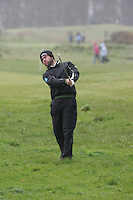 Robert Rock  playing his second shot from the rough on the 1st on day 3 of the 3 Irish open in Co Louth Golf Club Baltray..Pic Fran Caffrey/golffile.ie