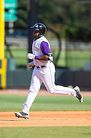 Courtney Hawkins (10) of the Winston-Salem Dash rounds the bases after hitting a home run against the Salem Red Sox at BB&T Ballpark on April 20, 2014 in Winston-Salem, North Carolina.  The Dash defeated the Red Sox 10-8.  (Brian Westerholt/Four Seam Images)
