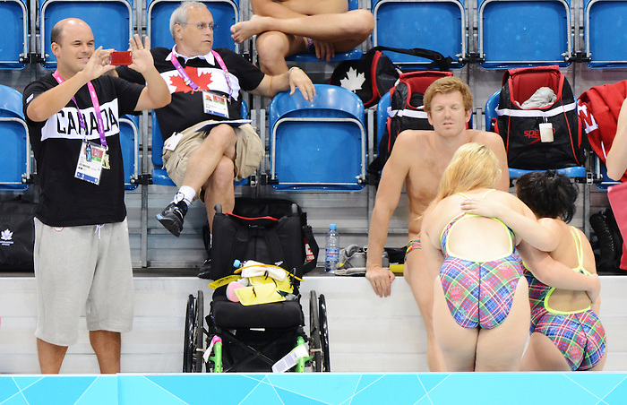 LONDON, ENGLAND – 08/24/2012: Peter Carpenter takes a photo of The Canadian Swim Team during a training session at the London 2012 Paralympic Games at The Aquatic Centre. (Photo by Matthew Murnaghan/Canadian Paralympic Committee)
