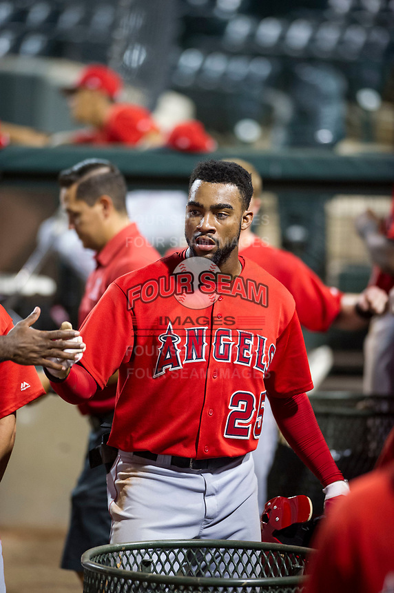 AZL Angels designated hitter Jordon Adell (25) is congratulated by teammates after scoring a run during a game against the AZL Indians on August 7, 2017 at Tempe Diablo Stadium in Tempe, Arizona. AZL Indians defeated the AZL Angels 5-3. (Zachary Lucy/Four Seam Images)