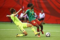 June 12, 2015: Ajara NCHOUT of Cameroon kicks the ball and scores during a Group C match at the FIFA Women's World Cup Canada 2015 between Cameroon and Japan at BC Place Stadium on 12 June 2015 in Vancouver, Canada. Japan won 2-1. Sydney Low/AsteriskImages