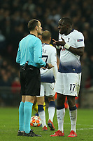 Moussa Sissoko of Tottenham Hotspur with the match referee during Tottenham Hotspur vs Borussia Dortmund, UEFA Champions League Football at Wembley Stadium on 13th February 2019