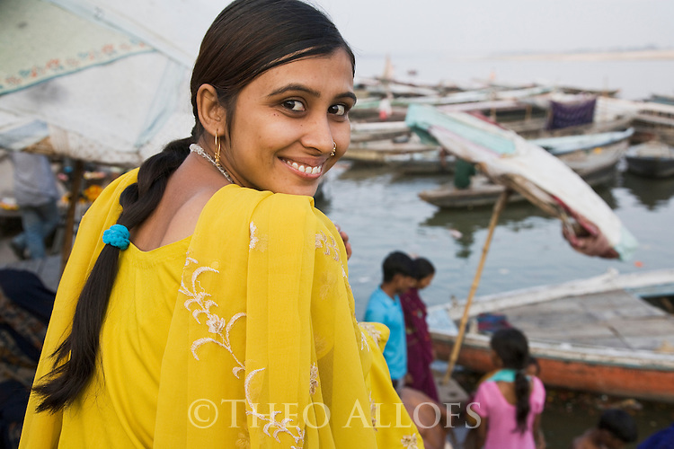 Young Indian woman at Ganges River;  Varanasi has been a cultural and religious center in northern India for several thousand years, Varanasi, Uttar Pradesh, India --- Model Released