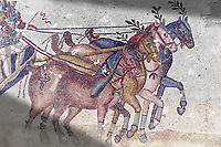 Close up of a chariot racing at the Circus Maximus Chariot racing at the Circus Maximus from the Palaestra room no 15.. Roman mosaics at the Villa Romana del Casale which containis the richest, largest and most complex collection of Roman mosaics in the world. Constructed in the first quarter of the 4th century AD. Sicily, Italy. A UNESCO World Heritage Site.
