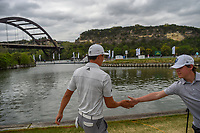 HaoTong Li (CHN) high fives a young fan as he heads to 13 tee during day 3 of the WGC Dell Match Play, at the Austin Country Club, Austin, Texas, USA. 3/29/2019.<br /> Picture: Golffile | Ken Murray<br /> <br /> <br /> All photo usage must carry mandatory copyright credit (© Golffile | Ken Murray)