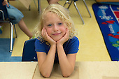 MR / Schenectady, NY. Zoller Elementary School (urban public school). Kindergarten classroom. Portrait of student (girl, 5). MR: Tor3. ID: AM-gKw. © Ellen B. Senisi.