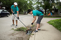 "Thomas Franco, left, and James Chen remove weeds from curbs in the Hawthrone neighborhood during ""Circle the City with Service,"" the Kiwanis Circle K International's 2015 Large Scale Service Project, on Wednesday, June 24, 2015, in Indianapolis. (Photo by James Brosher)"