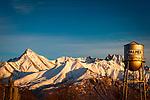 Palmer water tower and Matanuska Peak at sunset, Palmer, Matanuska Valley, Southcentral, Alaska, Winter.