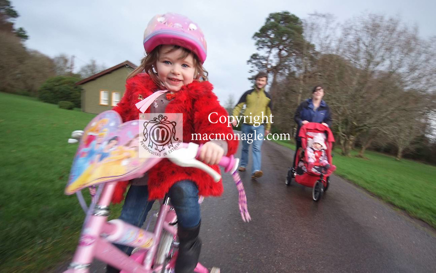 Amelie Hussey goes for a spin on her new bike through  Knockreer in Killarney National Park with parents John  and Sally and sister Sophie..Pictureby Don MacMonagle