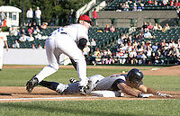May 30, 2004:  Outfielder Derek Nicholson of the Toledo Mudhens slides under Terry Tiffee of the Rochester Red Wings during a game at Frontier Field in Rochester, NY.  The Mudhens are the Triple-A International League affiliate of the Detroit Tigers.  Photo By Mike Janes/Four Seam Images