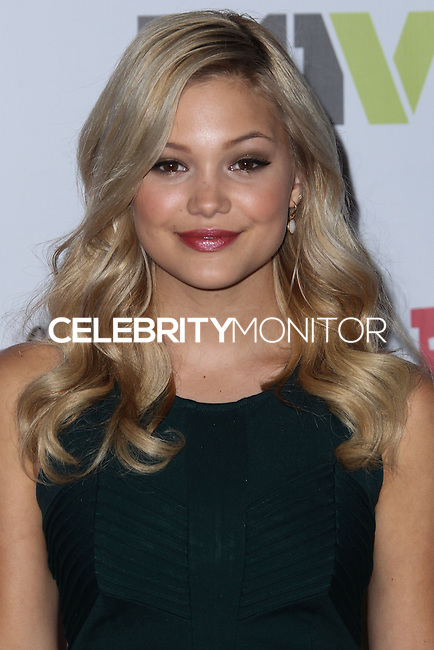 HOLLYWOOD, CA - DECEMBER 01: Olivia Holt arriving at the 82nd Annual Hollywood Christmas Parade held at Hollywood Boulevard on December 1, 2013 in Hollywood, California. (Photo by Xavier Collin/Celebrity Monitor)