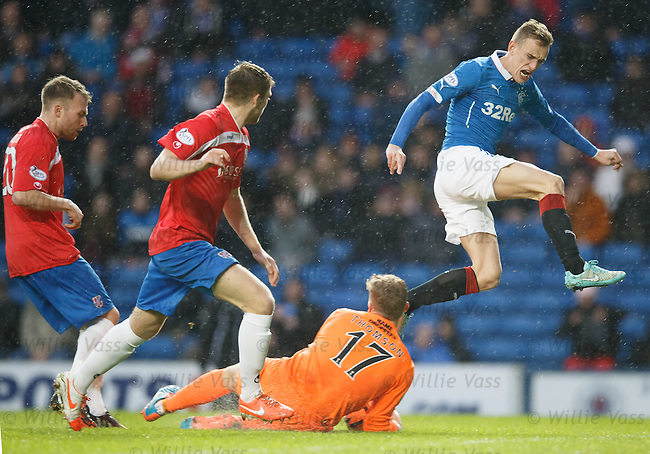 Dean Shiels has his effort saved by keeper Robbie Thomson