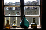 Bottles in window at Fort Ross