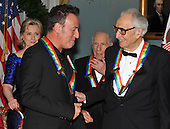 Washington, DC - December 5, 2009 -- 2009 Kennedy Center honorees Bruce Springsteen, left and Dave Brubeck engage in conversation as they and the other honorees prepare to pose for the formal group photo following the Artist's Dinner at the United States Department of State in Washington, D.C. on Saturday, December 5, 2009.  Secretary of State Hillary Rodham Clinton and honoree Mel Brooks look on from behind..Credit: Ron Sachs - Pool via CNP