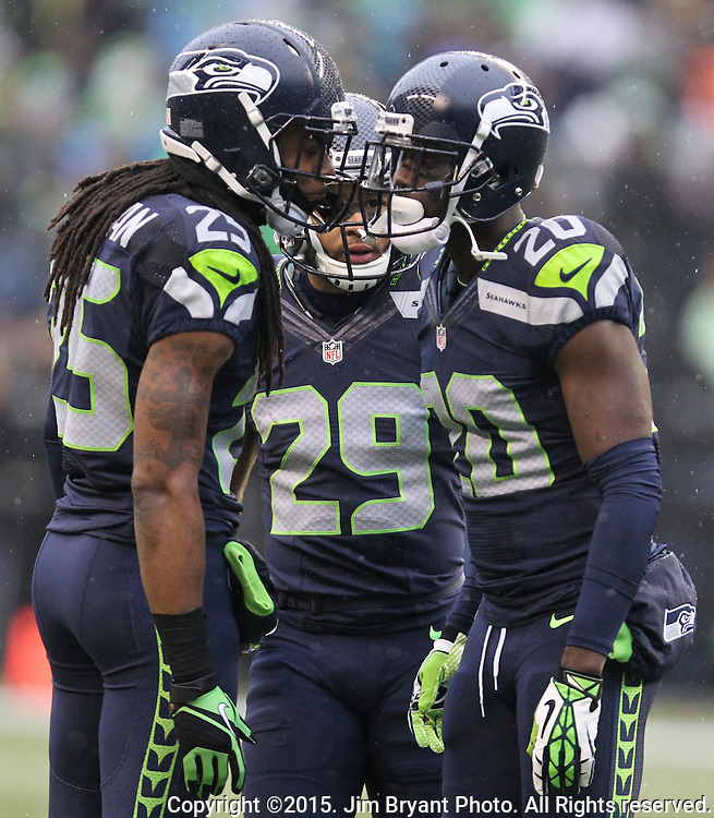 Seattle Seahawks defensive backs, Richard Sherman (25), Earl Thomas (29) and Jeremy Lane (20) huddle together during their game against the St. Louis Rams at CenturyLink Field in Seattle, Washington on December 27, 2015.  The Rams beat the Seahawks 23-17.      ©2015. Jim Bryant Photo. All Rights Reserved