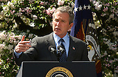 """U.S. President George W. Bush delivers remarks on the economy in the Rose Garden at the White House in Washington, DC on April 15, 2003.  The White House said in a later release """" As Americans file their income tax returns, the President encouraged Congress to provide the tax relief necessary to grow our economy and create  jobs.  The President has proposed $726 billion in tax relief to create 510,000  new jobs this year and a total of 1.4 million new jobs by the end of next year.<br /> Congress passed a budget ensuring that $550 billion of that amount can pass Congress with a simple majority vote using expedited procedures.  The President<br /> will work with Congress to ensure that the final package is at least that size and contains all the elements of his plan so the economy can grow and create as many new jobs as possible.  The President will not be satisfied until everyone looking for work can find it.""""  The President also spoke on the War with Iraq. The President said  """"Our victory in Iraq is certain, but it is not complete.  Centralized power of the dictator has ended  --  yet, in parts of Iraq, desperate and dangerous elements remain.  Forces of our coalition will engage these enemies until they surrender or until they're destroyed.   We have waged this war with determination and with clarity of purpose.  And we will see it through until the job is done.""""<br /> Credit: Ron Sachs / CNP"""