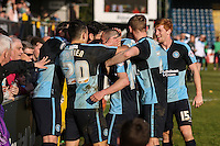 Michael Harriman of Wycombe Wanderers (centre) celebrates scoring the opening goal against Mansfield Town during the Sky Bet League 2 match between Wycombe Wanderers and Mansfield Town at Adams Park, High Wycombe, England on 25 March 2016. Photo by David Horn.
