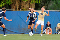 27 August 2011:  FIU's April Perry (6) passes the ball in the first half as the FIU Golden Panthers defeated the University of Arkon Zips, 1-0, at University Park Stadium in Miami, Florida.