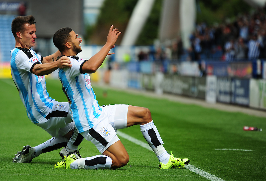 Huddersfield Town's Nahki Wells celebrates his goal<br /> <br /> Photographer Andrew Vaughan/CameraSport<br /> <br /> Football - The Football League Sky Bet Championship - Huddersfield Town v Blackburn Rovers - Saturday 15th August 2015 - The John Smith's Stadium - Huddersfield<br /> <br /> &copy; CameraSport - 43 Linden Ave. Countesthorpe. Leicester. England. LE8 5PG - Tel: +44 (0) 116 277 4147 - admin@camerasport.com - www.camerasport.com