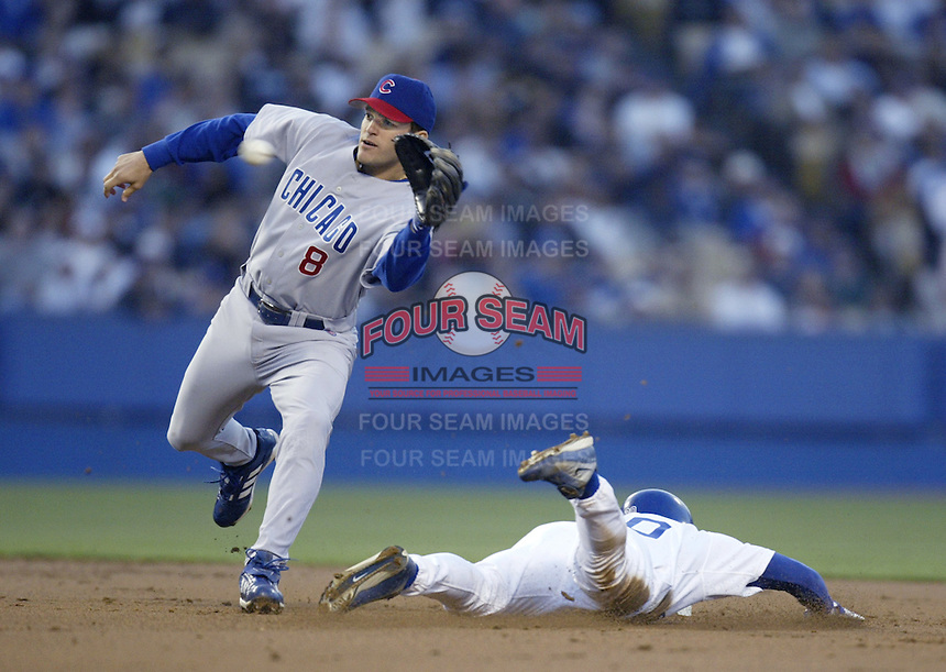 Alex Gonzalez of the Chicago Cubs reaches for a throw during a 2002 MLB season game against the Los Angeles Dodgers at Dodger Stadium, in Los Angeles, California. (Larry Goren/Four Seam Images)