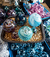 BNPS.co.uk (01202 558833)<br /> Pic:PhilYeomans/BNPS<br /> <br /> Infinite variety of shapes and colour.<br /> <br /> I'm forever blowing Baubles...!<br /> <br /> Britain's biggest hand blown Christmas bauble factory is working flat out at this time of year to keep up with demand for the festive favourite.<br /> <br /> 10,000 baubles are blown and individually signed every year at Bath Aqua Glass using raw silica for the blue tinged glass that is then coated with a mixture of copper, iron, manganese or even gold oxide to create colourful and unique designs.<br /> <br /> Evidence of glass making dating back to Roman times have been discovered in the historic Somerset town and boss Annette Dolan keeps the tradition alive with the delicate creations being sent all over the world.