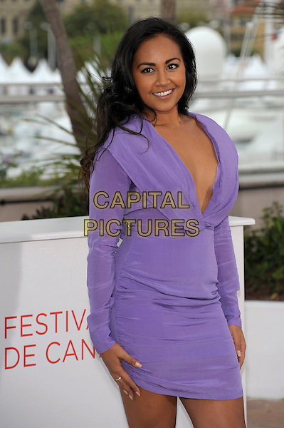 Jessica Mauboy.'The Sapphires' photocall at the 65th  Cannes Film Festival, France,.20th May 2012..half length purple lilac dress long sleeve mini sweat patch sweaty low cut plunging neckline .CAP/PL.©Phil Loftus/Capital Pictures.