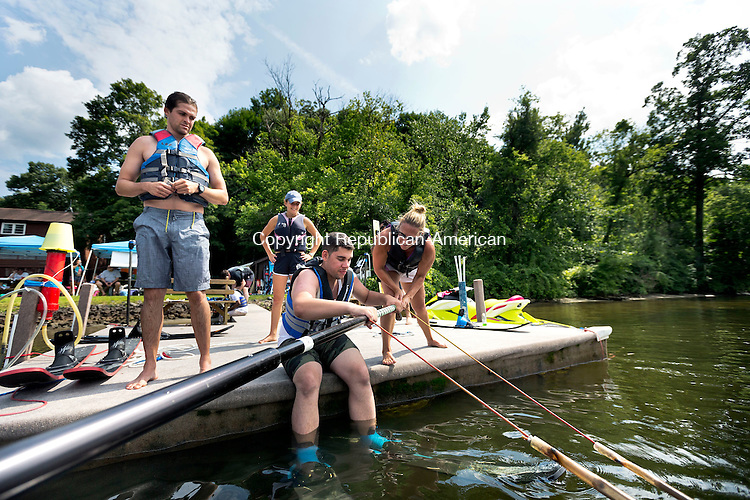 Southbury, CT- 17 July 2015-071715CM02- Elizabeth O'Connell, right, a volunteer from Newton helps John Diodato who was learning to waterski on Lake Zoar in Southbury on Friday.  Diodato who is visually impaired, was leaning to waterski with the help of Leap of Faith Adaptive Skiers, an organization based out of Newton, CT.   Looking on from the boatdock is Brenton Hard, with VISIONS.   Christopher Massa Republican-American