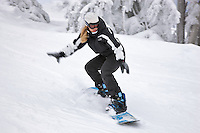 Young girl snowboading at Timberline, Oregon