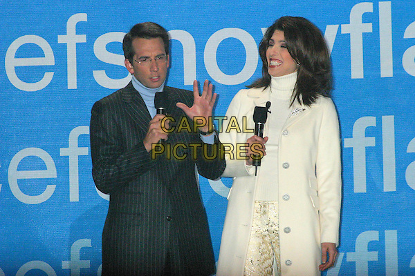 DAVID PRICE & LYNDA LOPEZ.Lights New UNICEF Crystal Snowflake at the Plaza Hotel in New York City..November 18, 2004.half length, stage, microphone.www.capitalpictures.com.sales@capitalpictures.com.© Capital Pictures.