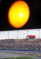 Feb 22, 2009; Fontana, CA, USA; NASCAR Sprint Cup Series drivers drive under the caution for rain during the Auto Club 500 at Auto Club Speedway. Mandatory Credit: Mark J. Rebilas-