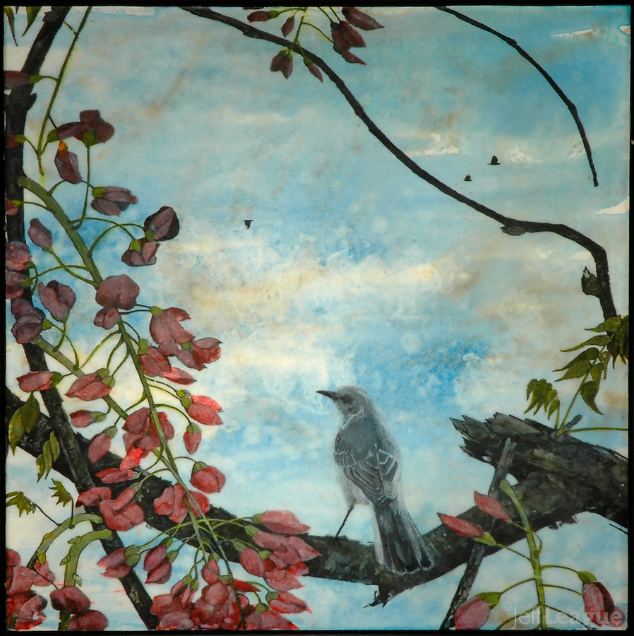 Photo transfer of mocking bird on branch with blossoms over encaustic painting.