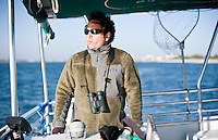 Captain Joe searches the horizon for birds and other wildlife, aboard the Shamrock.