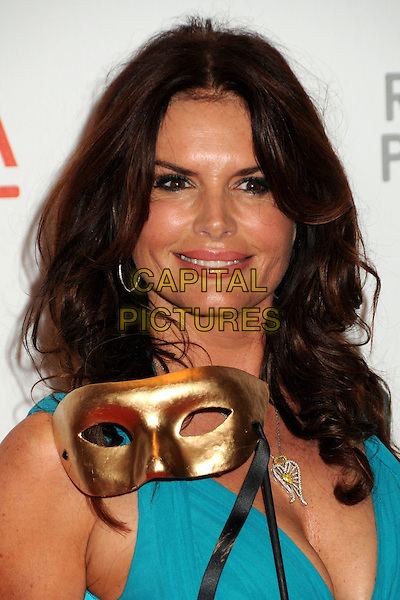 "ROMA DOWNEY .LACMA's ""The Unmasking"" of the Lynda & Stewart Resnick Exhibition Pavilion Opening Gala held at the Los Angeles County Museum of Art, - Los Angeles, California, USA, 25th September 2010..portrait headshot  blue turquoise gold mask .CAP/ADM/BP.©Byron Purvis/AdMedia/Capital Pictures."