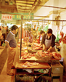 CHINA, Hangzhou, customer and butchers at meat shop