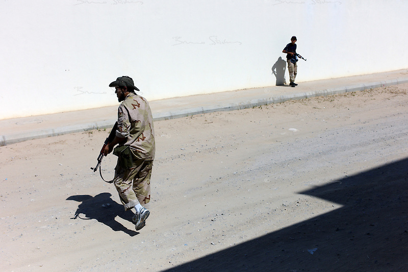 Tripoli, Libya, August 24, 2011.A group of rebels secure an area in Souk al Juma, where a secret meeting of NTC leaders is taking place..