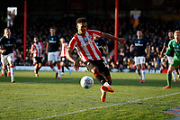 8th February 2020; Griffin Park, London, England; English Championship Football, Brentford FC versus Middlesbrough; Ollie Watkins of Brentford keeps the ball in play on the line