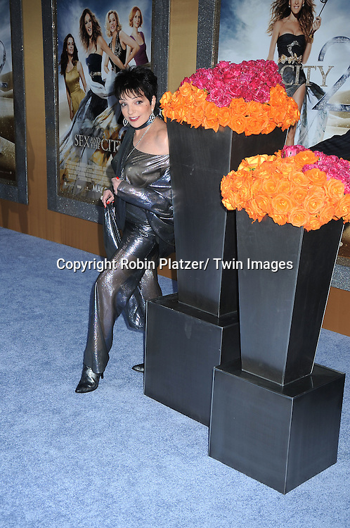 """actress Liza Minnelli posing for photographers at the world premiere of """"Sex and the City 2"""" on May 24, 2010 at Radio City Music Hall in New York City."""