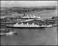 BNPS.co.uk (01202 558833)<br /> Pic: Aerofilms/HistoricEngland/BNPS<br /> <br /> Sister ship to the Titanic - RMS Olympic, in Southampton, April 1933.<br /> <br /> Stunning historic aerial photos of seaside towns, naval bases, ports and shipyards which tell the story of Britain's once-great maritime tradition feature in a new book.<br /> <br /> The fascinating archive of black and white images includes views from a bygone age such as Brighton's famous West Pier, Grimsby's burgeoning fishing fleet, and London's dock yards.<br /> <br /> Iconic ships were also captured from the skies including the Cutty Sark in its final seaworthy years on the Thames, HMY Britannia in 1959, the RMS Queen Mary in 1946 and the SS Queen Elizabeth in 1969 about to make her maiden voyage.<br /> <br /> England's Maritime Heritage from the Air, by Peter Waller, is published by English Heritage and costs &pound;35.