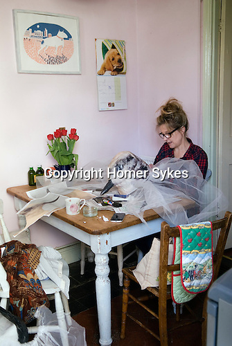 Made In Spring. Roath Cardiff Wales. MiR artist Gail Howard adding finishing touches to the May Queen's attendants outfits. May 2014