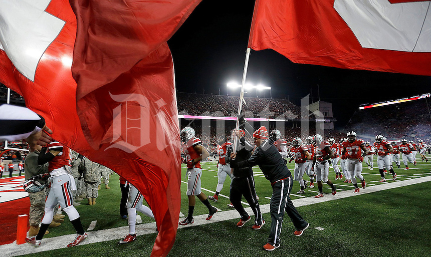The Ohio State team runs on the field prior to the NCAA football game at Ohio Stadium on Saturday, November 1, 2014. (Columbus Dispatch photo by Jonathan Quilter)