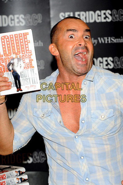 Louie Spence.Book signing at Selfridges, Oxford Street, London, England..28th September 2011.half length funny blue white print shirt mouth open stubble facial hair check.CAP/CJ.©Chris Joseph/Capital Pictures.