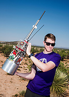 Lucas Heflin from the University of Washington with a payload device structure at the Spaceport America Cup near the town of Truth or Consequences, New Mexico, Thursday, June 22, 2017. The International Intercollegiate Rocket Engineering Competition hosted over 110 teams from colleges and universities in eleven countries. Students launched solid, liquid, and hybrid rockets to target altitudes of 10,000 and 30,000 feet. The 2017 Spaceport America Cup winner was the University of Michigan, Ann Arbor, Team 79.<br /> <br /> Photo by Matt Nager