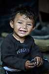 "THIS PHOTO IS AVAILABLE AS A PRINT OR FOR PERSONAL USE. CLICK ON ""ADD TO CART"" TO SEE PRICING OPTIONS.   Two-year old Kamber Musliu lives in Suto Orizari, Macedonia. The mostly Roma community, located just outside Skopje, is Europe's largest Roma settlement. ."