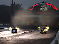 Sep 3, 2016; Clermont, IN, USA; NHRA top fuel driver Steve Torrence (left) races alongside Shawn Langdon during qualifying for the US Nationals at Lucas Oil Raceway. Mandatory Credit: Mark J. Rebilas-USA TODAY Sports