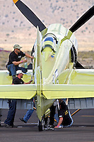 Ground crew members tend to the Hawker Sea Fury Furias during the 2011 Reno National Championship Air Races